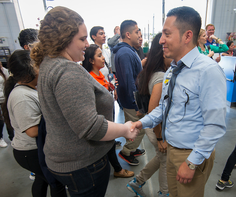 Walmart store manager Zain Mariscal talks with Scarborough High School students, May 22, 2014.