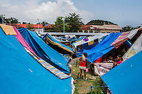 Child survivors of the Zamboanga City rebel attack walk around the shared evacuee's tent in the city's largest stadium in Zamboanga, Mindanao, The Philippines on November 4, 2013. The Internally Displaced People (IDP) have set up shared tents along the running track and in the breachers in this stadium after surviving the 3 week long attack by MNLF rebels. Photo by Suzanne Lee for SPRINT-IPPF