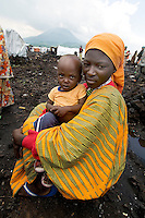 Fraha sits with her baby son Shukuru in the Kibati IDP (Internally Displaced Persons) camp.