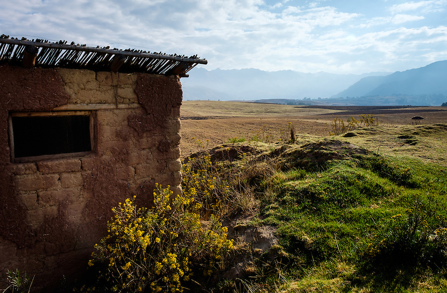 CHINCHERO, PERU - CIRCA OCTOBER 2015:  Farm land and mountains close to Chinchero on the Cusco region known as Sacred Valley