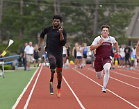 NWA Democrat-Gazette/BEN GOFF @NWABENGOFF<br /> Richard Browne (left), a member of the 2012 U.S. Paralympic Team origionaly from Jackson, Miss., runs alongside Kaiden Thrailkill of Silioam Springs in the first heat of the 100 meter dash Thursday, April 20, 2017, during the Never Say Never Foundation's Battle of the Blades at the McDonald Relays at Fort Smith Southside.