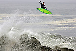 Jul 25, 2009 - Newport Beach, California, USA - A surfer catches air as high surf pounds south facing Southern California beaches this weekend, with especially dangerous and high surf at The Wedge