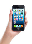 Hand holding Apple iPhone 5 black with blue desktop on its display isolated on white background