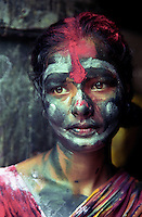 A lady smeared with Gulal.