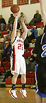 SOUTHBURY, CT, 01/02/08- 010208BZ11- ACTION MAN-- Pomperaug's Chris Comeau (22) shoots against Bunnell during their game at Pomperaug High School in Southbury Wednesday night.<br /> Jamison C. Bazinet Republican-American