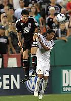 Santino Quaranta #25 of D.C. United wins a header from A.J. DeLaGarza #20 of the Los Angeles Galaxy during an MLS match at RFK Stadium on July 18 2010, in Washington D.C. Galaxy won 2-1.
