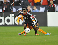 Marcos Sanchez(25) of D.C. United keeps possession of the ball. The Houston Dynamo defeated D.C. United 4-0, at RFK Stadium, Wednesday May 8 , 2013.