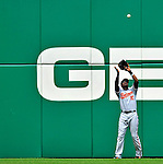 24 May 2009: Baltimore Orioles' center fielder Adam Jones pulls in a fly ball during a game against the Washington Nationals at Nationals Park in Washington, DC. The Nationals rallied to defeat the Orioles 8-5 and salvage a win in their interleague series. Mandatory Credit: Ed Wolfstein Photo