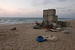 Military concrete cubes and a dog on the beach, at the outpost of Shirat Hayam, in the Israeli settlement bloc of Gush Katif, Gaza Strip.