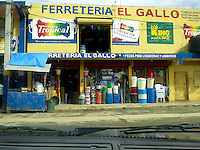 Mercado of town of Samana, a major stop for guaguas and taxis. Taken from inside our guagua.