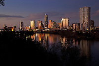 Austin, Texas Skyline at Sunset overlooking Town Lake with a view of the Congress Avenue Bridge.