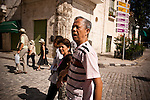 """Cristina Apón Peña, director of the Residencia del Anciano Chino, leads the Chinese-Cuban seniors to watch tai chi in Plaza Vieja, in Old Havana, Cuba, on Saturday, April 26, 2008. """"There were many Chinese that traveled to Cuba with the dream of finding fortune,"""" said  Peña. """"They left behind young wives and babies in hopes of fulfilling that dream and returning to China soon.""""."""