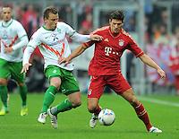 FUSSBALL   1. BUNDESLIGA  SAISON 2011/2012   15. Spieltag FC Bayern Muenchen - SV Werder Bremen        03.12.2011 Philipp Bargfrede (li, SV Werder Bremen)  gegen Mario Gomez (FC Bayern Muenchen)