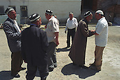 Uzbek men greet each other at the Abdullakhan Rabat mosque, after prayers, in the city of Osh. The city was once one of the great cities of the Silk Road and of Central Asia, and is the second biggest city in the country, situated in the unstable Ferghana valley which is now becoming a hotbed if Islamic Fundamentalism. Osh, Kyrgyzstan.