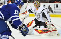 San Antonio Rampage goaltender Jacob Markstrom, right, makes a save as Toronto Marlies left wing David Broll closes in on the net during an AHL hockey game, Sunday, Nov. 24, 2013, in San Antonio. (Darren Abate/AHL)