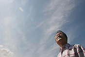 Motoharu Nakagawa, aged 69, looks at the skies above Kokura and remebers how, 60 years ago, he saw the American B29 Bomber plane 'Bock's Car', carrying an atomic bomb destined for Kokura, but dropped over Nagasaki instead on August 9th 1945..Kokura, Japan, 7th August 2005.