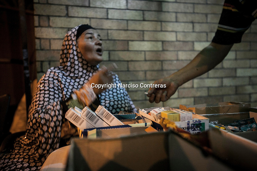 In this Thursday, Aug. 08, 2013 photo, an elder woman and supporter of the ousted president Mohammed Morsi awaits for medicine at the farmacy of the field hospital in the sit-in of the Cairo University at Giza district. (Photo/Narciso Contreras).