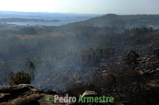General view shows burnt forests in Boiro, on August 16, 2010, near A Coruna.  Pedro ARMESTRE