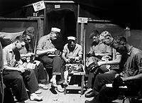 Men at Munsan-ni, preparing for inspection prior to acting as honor guard at signing of armistice at Panmunjom, Korea.  Navy men shining their shoes.  July 23, 1953. (Navy)<br /> NARA FILE #:  080-G-625791<br /> WAR &amp; CONFLICT BOOK #:  1390