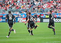 August 21 2010 D.C. United defender Julius James #2 celebrates his goal with D.C. United defender Jordan Graye #16, D.C. United midfielder Stephen King #20 and D.C. United midfielder Santino Quaranta #25 during a game between DC United and Toronto FC at BMO Field in Toronto..DC United won 1-0.