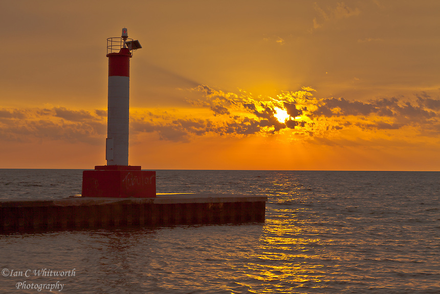 A beautiful sunrise over Lake Ontario in Oakville at the Lighthouse pier