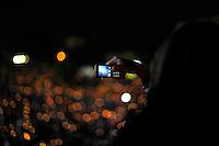 Veglia a lume di candela al Circo Massimo.Folla di fedeli mentre prega durante la veglia per la beatificazione di Papa Wojtyla. .Candlelight vigil at the Circus Maximus. Crowd of faithful prays during the vigil for the beatification of Pope Wojtyla...