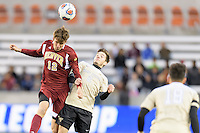 Houston, TX - Friday December 9, 2016: Graham Smith (12) of the Denver Pioneers wins a header over Luis Argudo (2) of the Wake Forest Demon Deacons at the NCAA Men's Soccer Semifinals at BBVA Compass Stadium in Houston Texas.