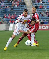 New York defender Brandon Barklage (25) fights off a challenge from Chicago midfielder Daniel Paladini (11).  The Chicago Fire defeated the New York Red Bulls 3-1 at Toyota Park in Bridgeview, IL on April 7, 2013.