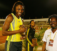 "Aleen Bailey clutching her 1st. place award that was presented to her by Alfred ""Frano"" Francis at the Jamaica International Invitational Meet on Saturday, May 2nd. 2009. Photo by Errol Anderson, The Sporting Image.net"
