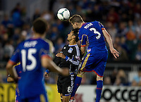 Chris Wondolowski of Earthquakes battles for the ball in the air against Drew Moor of Rapids during the game at Buck Shaw Stadium in Santa Clara, California on May 18th, 2013.  San Jose Earthquakes tied Colorado Rapids, 1-1.