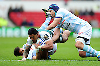 Manu Tuilagi of Leicester Tigers is tackled to ground. European Rugby Champions Cup semi final, between Leicester Tigers and Racing 92 on April 24, 2016 at The City Ground in Nottingham, England. Photo by: Patrick Khachfe / JMP