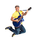 Happy smiling young man guitar player jumping with an acoustic guitar in the air isolated on white background