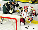 12 November 2010: Boston College Eagle forward Cam Atkinson, a Junior from Greenwich, CT, is checked by UVM defenseman Drew MacKenzie, a Junior from New Canaan, CT, during game action against the University of Vermont Catamounts at Gutterson Fieldhouse in Burlington, Vermont. The Eagles edged out the Cats 3-2 in the first game of their weekend series. Mandatory Credit: Ed Wolfstein Photo