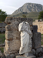 CORINTH, GREECE - APRIL 16 : A detail of the South Stoa, on April 16, 2007 in Corinth, Greece. The South Stoa, on the south side of the Forum, was built in the 4th century BC but had been reconstructed before the Romans razed the city in 146 BC. Originally shops, the Romans converted the building into offices such as the council hall, or bouleuterion. Outside was a terrace with a wall on which were many sculptures. This statue of a woman, placed here in modern times, is seen in the early morning light. Corinth, founded in Neolithic times, was a major Ancient Greek city.(Photo by Manuel Cohen)