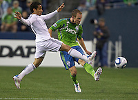 Seattle Sounders FC midfielder Tyson Wahl pass the ball away from Vancouver Whitecaps FC  forward Camilo Sanvezzo during play at Qwest Field in Seattle Saturday June 11, 2011. The game ended in a 2-2 draw.