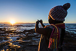 Photographing the sunrise over the sea, False Bay, Western Cape, South Africa