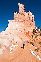 Female hiker on scenic Queens Garden trail, Bryce Canyon national park, Utah, USA