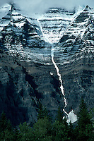 Snow delineating the ridges along the top of Mount Robson, BC.