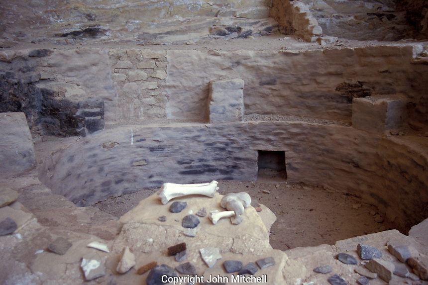 Pottery shards and bones on the edge of a kiva, Ute Mountain Tribal Park, Colorado, U.S.A.