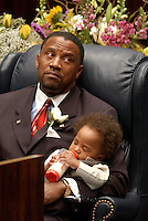 TALLAHASSEE 3/4/03-Sen. Gary Siplin, D-Orlando, holds his son Joshua, age 1, while he has a bottle during opening day festivities of the 2003 legislative session Tuesday at the Capitol in Tallahassee. COLIN HACKLEY PHOTO