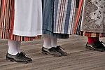 Shoes and costumes of folk dancers in Stockholm, Sweden performing at Skansen, a park full of traditional builings and farmsteads from all over Sweden