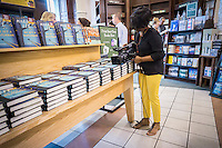 "A television cameraperson videos for a news story on the release of ""Go Set a Watchman"" by Harper Lee in a Barnes & Noble bookstore in New York on Tuesday, July 14, 2015. The famed Pulitzer Prize winning author Harper Lee's  second novel, ""Go Set A Watchman"" is a sequel to ""To Kill a Mockingbird"" published 50 years ago. Watchman was actually written prior to Mockingbird and was recently found after being thought lost. (© Richard B. Levine)"