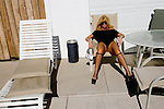 "Sex worker Mia Morgan waits for her weekly, mandatory, medical exam at the Moonlite Bunny Ranch brothelin Mound House, NV on Thursday, July 27, 2006...The Moonlite Bunny Ranch brothel in Mound House, Nevada - just a few miles from the state capital in Carson City - first opened in 1955. The Ranch is a legal, licensed brothel owned by Dennis Hof. It's featured in the HBO series ""Cathouse."""