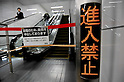 March 22, 2011, Tokyo, Japan - Escalators are put out of service TokyoÅfs Shibuya station as railway operators reduce or suspend services in power rationing on Tuesday, March 22, 2011. Tokyo Electric Power Co. began its first-ever rolling blackout from March 14 to help prevent an unexpected large-scale power outage after a powerful earthquake shut two nuclear plants indefinitely on March 11. (Photo by AFLO) [3620] -mis-