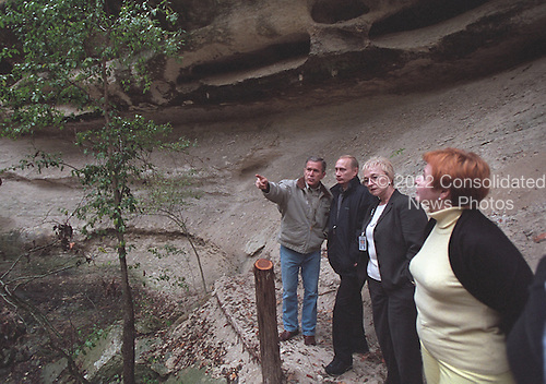 United States President George W. Bush and President Vladimir Putin of Russia tour a canyon and waterfall at the Bush Ranch in Crawford, Texas, Wednesday, November 14, 2001. Also pictured are Russian First Lady Lyudmila Putin, far right, and interpreter Irene Firsow. .Mandatory Credit: Eric Draper / White House via CNP