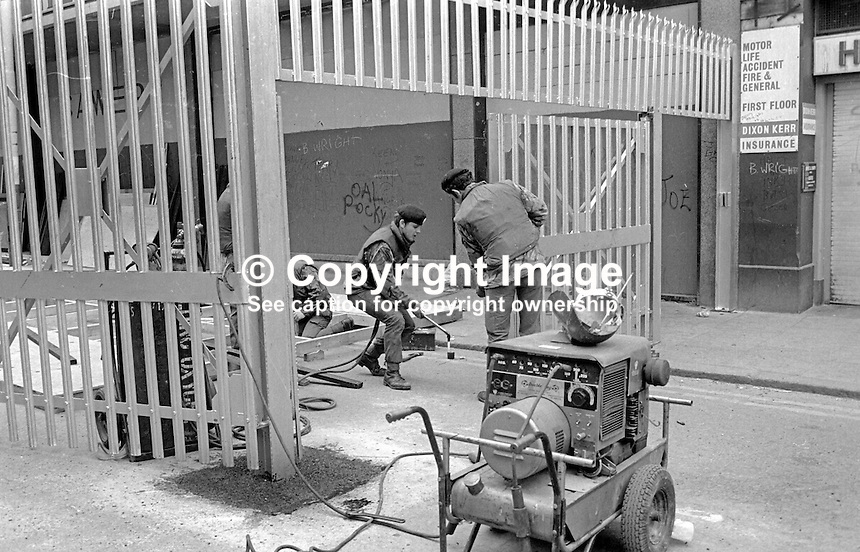 British soldiers spend Sunday 28th March 1976 erecting new security barriers in the main shopping area of Belfast, N Ireland, UK. 197603280169c<br />