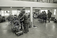 OCKHAM, SURREY - MAY, 1976: Crew members of the Tyrrell Formula 1 team work on the Project 34 grand prix cars between races in May, 1976, at team headquarters in Ockham, Surrey, United Kingdom.