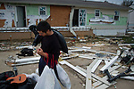 John Moniz prepares to leave the remnants of his home, trying to salvage clothes in Union Beach, NJ after Superstorm Sandy. Superstorm Sandy's storm-surge, which destroyed several oceanfront blocks of Union Beach, leveled homes or lifted them off their foundations, breaking them apart and moving them.