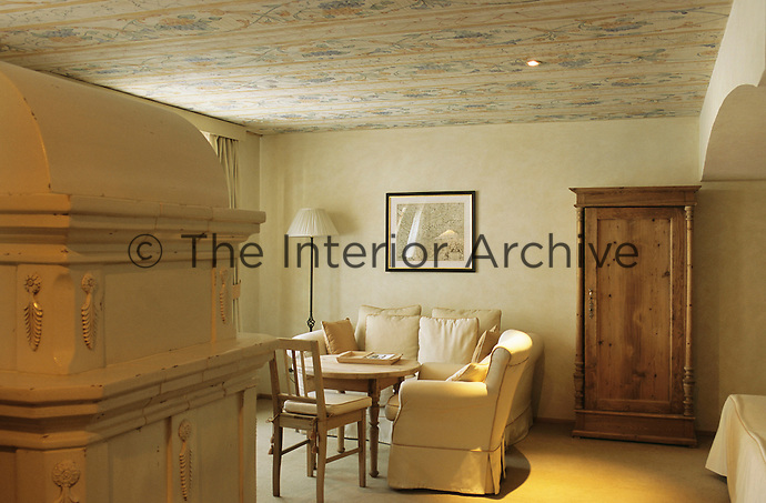 The Suite Giardino with an intricate floral pattern on the ceiling at the Hotel & Spa Rosa Alpina in the Dolomites