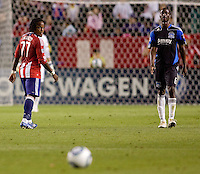 Chivas USA forward Chukwudi Chijindu (77) and San Jose Earthquakes defender Ike Opara (6) look for the ball. CD Chivas USA defeated the San Jose Earthquakes 3-2 at the  at Home Depot Center stadium in Carson, California on Saturday April 24, 2010.  .